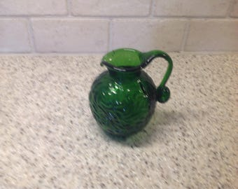 Small green pitcher