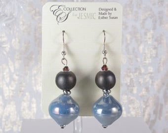 "Iridescent Blue Pearls Under Black Sheen Ball with Silver Finish Accents. Silver Finish French Hooks. Nickle Free.  2.25"" Long"