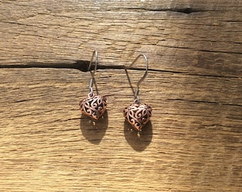 Copper 3d heart earrings on stainless steel wires.