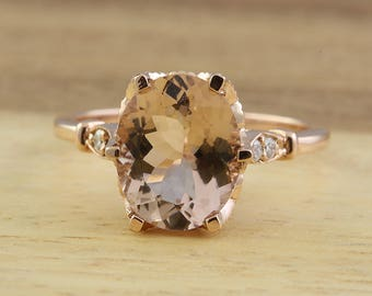 Morganite and diamond engagement ring in 14k rose gold