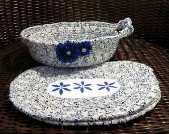 Blue flowered corded basket and 2 placemats.