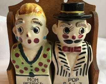 Vintage Mom & Pop salt and pepper shakers in original holder from the 1950's