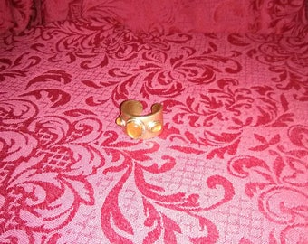 Vintage gold tone thick band ring with amber stones.