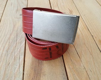 Rough belt made of red firehose used by Dutch firefighters