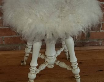 Vintage piano stool with Icelandic fleece seat.
