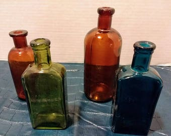 4 Vintage Glass Bottles