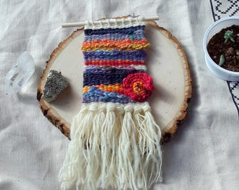 Small Weaving with Hand Spun Wool, Silk, Mohair, Sparkle in reds, blues, and natural white with crocheted flower