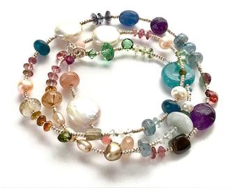 Semi precious gemstone and pearl wrap bracelet. Amethyst, tourmaline , coral,crystal, kyanite.