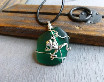 Handmade seaglass green pendant with frog wire wrapped leather cord