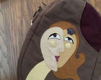 Sturdy Goddess With Buterfly Bead Oval Canvas Shoulder Bag with front and back pockets.
