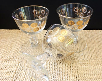 Set of three mid century sherry glasses. Gold leaf flower design.
