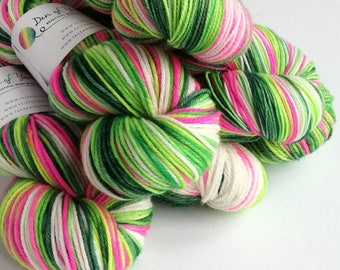 Hand dyed yarn pre-order.  Whoville colourway, variegated wool yarn. Dyed to order. Christmas yarn, you choose base.  Pink and greens