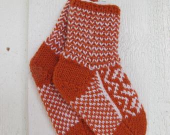 Handknitted norwegian socks in orange and white for children