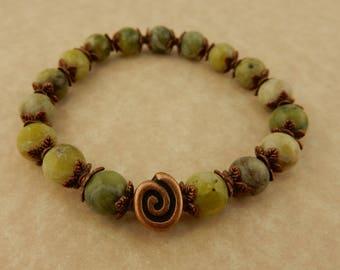 Irish Connemara Marble Stretch bracelet with Copper Celtic Spiral beads