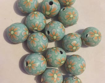 Pack of 15 x 10mm polymer clay round light blue with orange coloured flower beads.