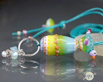 sra handmade lampwork bead jewellery bird egg pendant glass handmade by artist manuela