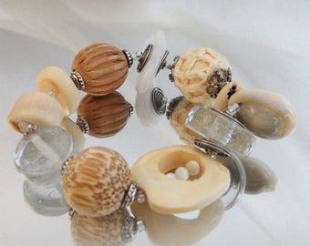 SALE Vintage Glass Bone Shell Charm Bracelet. Carved Wood Beads. Cowrie Shells.