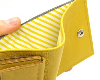 Yellow and grey leather wallet, six card slots, coin pocket and notes pocket