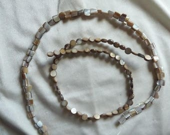 Beads, 2 Strands of Tan Mother of Pearl, 1 is a 6mm flat coin and 1 is a 8x6-10x6mm mini nugget. Sold per 15 inch strands.