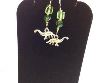 D I N O S A U R S- green glass beads and silver wire --wrapped dinosaur earrings.