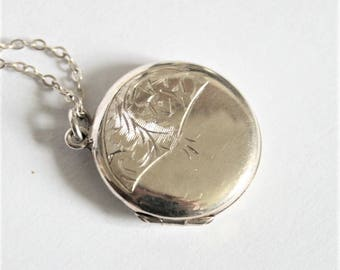 Vintage sterling silver locket on a chain.
