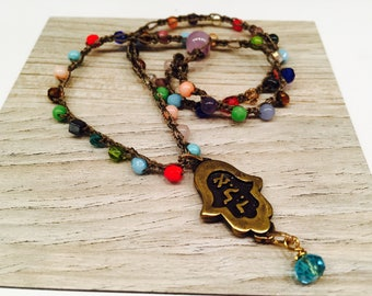 Chamsa charm with Hebrew Letters Aleph Lamed Dalet on a multi colored necklace