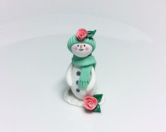 Christmas snowman ornament in miniature handmade from polymer clay