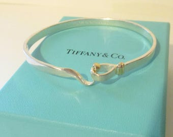 Tiffany & Co. 18Kt Yellow Gold and Sterling Silver Hook and Eye Bangle Bracelet