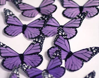 Purple edible butterflies, 12 wafer paper monarch butterflies for cake decorating and cupcake toppers. Butterflies for wedding cake toppers