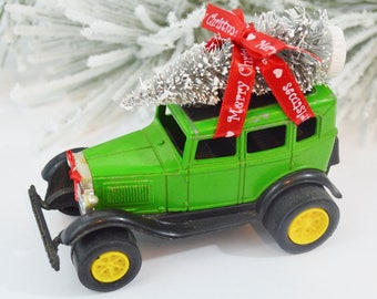 Ford Model A Sedan Decorated Vintage Diecast with Bottle Brush Christmas Tree Bow Merry Chistmas Ribbon Decoration Green Red White