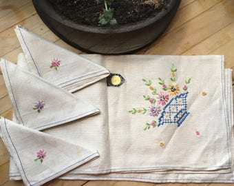 Vintage hand embroidered pure linen tea towel and three matching napkins with original sticker