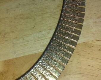 Vintage 1980s goldtone textured metal choker necklace