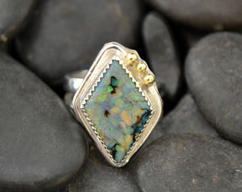 Sterling Opal ring with 18k gold accents.  size 6.5  heavy double band