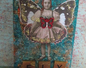 eclectic whimsical display vintage child girl photograph reclaimed wood home decor book shelf display Butterfly wing