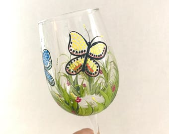 Hand painted butterfly design wine glasses can be personalized