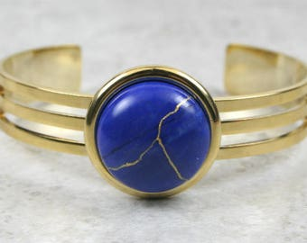 Kintsugi (kintsukuroi) cuff bracelet with lapis dyed howlite stone cabochon with gold repair in a gold plated setting - OOAK