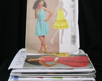 Lot of 12 patterns, sizes 4 - 14, Simplicity 2440 and 2552, McCall's 5985, 5621, 5818, 5934, 5931, 5586, 5800, 5923, 5879 and 5873, bargain