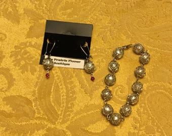 Ornate bracelet and earrings with Swarovski  crystal
