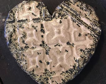 Ornate dark brown/black and creamy rose heart designed with antique tin ceiling tile