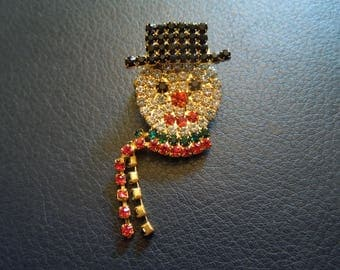 Vintage Christmas Brooch or Pin.  Snowman in White, Black, Red and Green Rhinestones.  Excellent Condition.