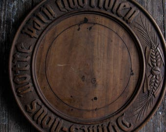 round carved french bread board