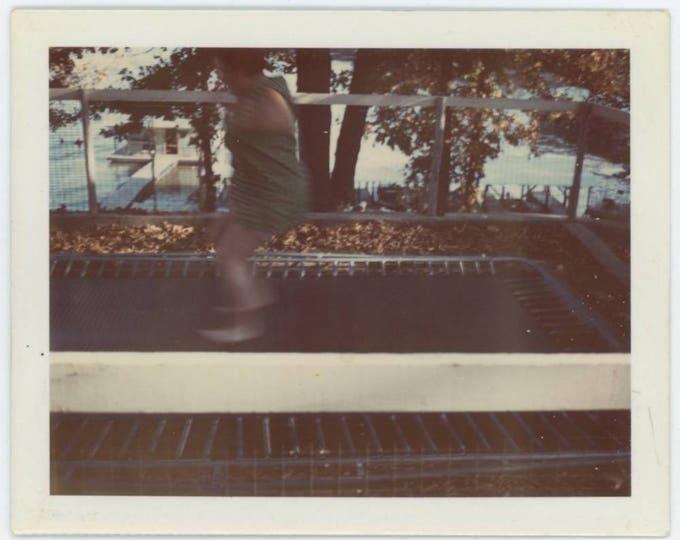 Vintage Polaroid Photo Snapshot: Blurred Figure on Trampoline, c1960s-70s (77590)