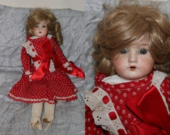 Antique Bisque Doll - Unmarked - Canvas Body - Blue Glass Sleep Eyes - Bisque Hands - Feet are Damaged - Neck has been Repaired