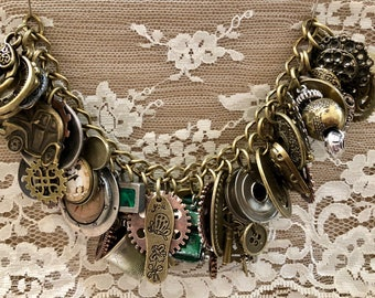 Charm  Bracelet Loaded With Charms.  In Antique Bronze and Silver Tones.