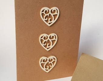"""The card """"Hearts"""" wood with its envelope"""