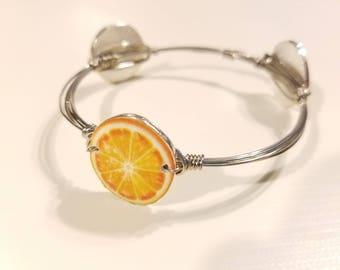 Orange Beaded Bangle Bracelet