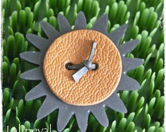 Flower ring in inner tube and brown leather