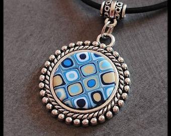 Medallion in cream blue polymer clay pendant