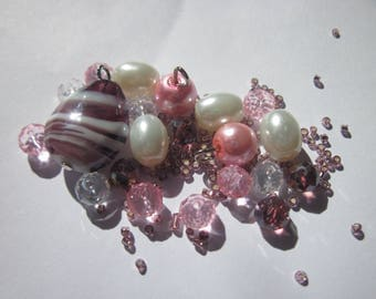 21 glass beads 6-19 mm with seed beads (O27)