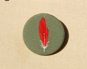Small red feather embroidered brooch